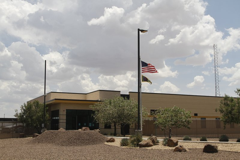 The entrance to the Border Patrol station in Clint, Texas, Wednesday, June 26, 2019. Migrant children being housed at the Border Patrol facility near El Paso appeared mostly clean and were being watched by hallway monitors on Wednesday, less than a week since they reported living there in squalid conditions with inadequate food, water and sanitation. (AP Photo/Cedar Attanasio)