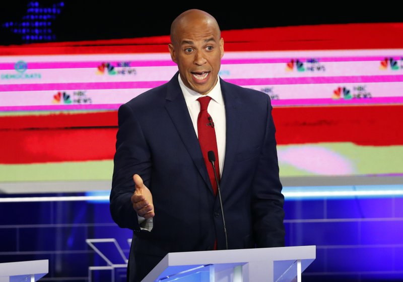 Democratic presidential candidate Sen. Cory Booker, D-N.J., speaks at a Democratic primary debate hosted by NBC News at the Adrienne Arsht Center for the Performing Art, Wednesday, June 26, 2019, in Miami. (AP Photo/Wilfredo Lee)