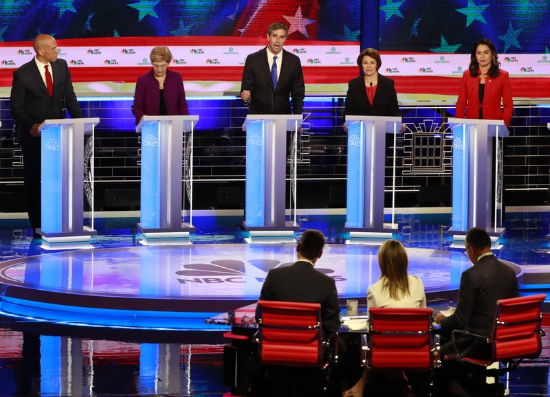 Democratic presidential candidate former Texas Rep. Beto O'Rourke, center, answers a question, during a Democratic primary debate hosted by NBC News at the Adrienne Arsht Center for the Performing Art, Wednesday, June 26, 2019, in Miam, as from left, Sen. Cory Booker, D-N.J., Sen. Elizabeth Warren, D-Mass., Sen. Amy Klobuchar, D-Minn., and Rep. Tulsi Gabbard, Hawaii, listen. (AP Photo/Wilfredo Lee)