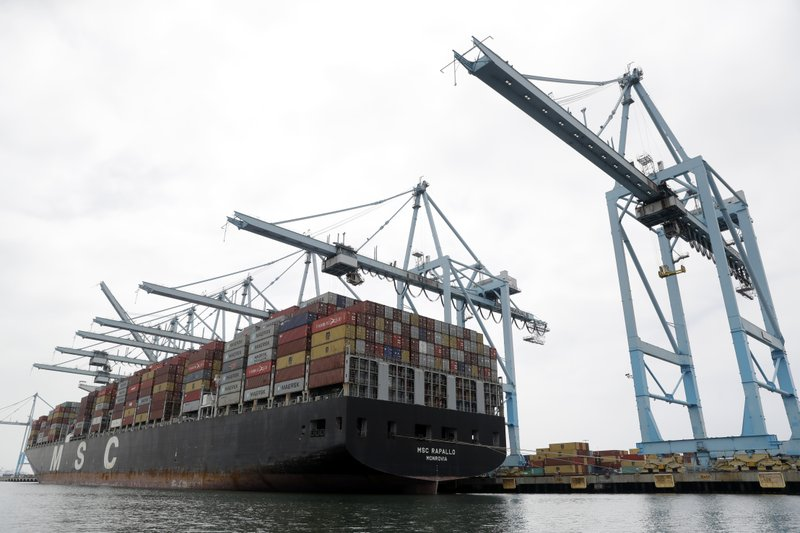 FILE - In this June 19, 2019, file photo a cargo ship is docked at the Port of Los Angeles in Los Angeles. On Thursday, June 27, the Commerce Department issues the third and final estimate of how the U.S. economy performed in the January-March quarter. (AP Photo/Marcio Jose Sanchez, File)