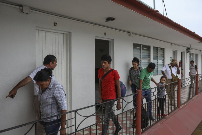Central American migrants are detained during a raid by Mexican immigration agents at the Azteca Hotel in Veracruz, Mexico, Thursday, June 27, 2019. Under increasing U.S. pressure to reduce the flow of hundreds of thousands of Central Americans through Mexican territory, Mexico's government has stepped up enforcement. (AP Photo/Felix Marquez)