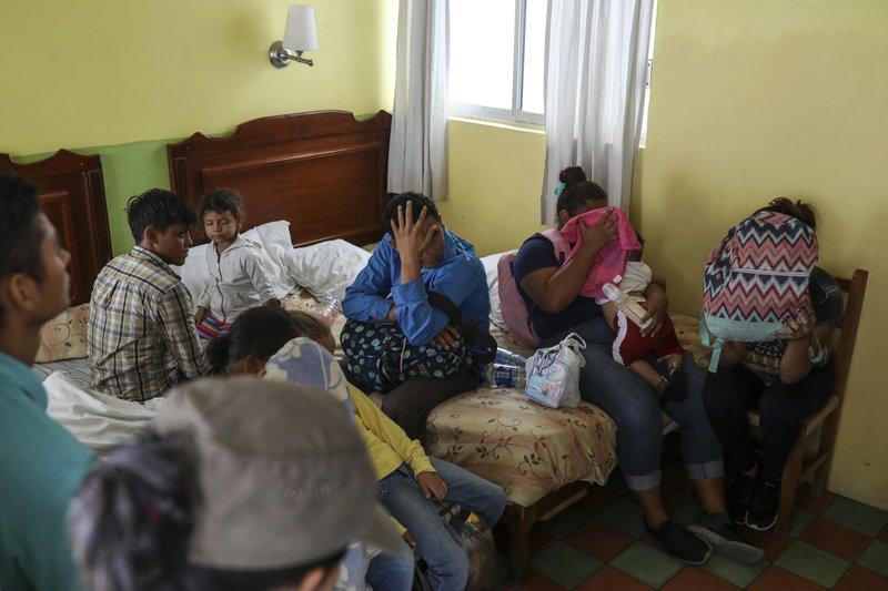 Central American migrants sit together inside a room at the Latino hotel during a raid by Mexican immigration agents in Veracruz, Mexico, Thursday, June 27, 2019. Under increasing U.S. pressure to reduce the flow of hundreds of thousands of Central Americans through Mexican territory, Mexico's government has stepped up enforcement. (AP Photo/Felix Marquez)