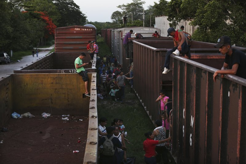 In this June 24, 2019 photo, migrants wait for the departure of a northbound freight train, in Salto del Agua, Mexico. The Mexican crackdown on migrants prompted by pressure from the Trump administration has pushed Central American migrants to seek new ways to try to reach the U.S. border. (AP Photo/Marco Ugarte)