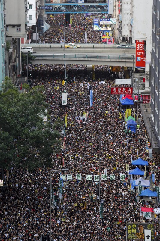 Ten of thousands of protesters flood the streets as they take part in a rally Monday, July 1, 2019, in Hong Kong. Combative protesters tried to break into the Hong Kong legislature Monday as a crowd of thousands prepared to start a march in that direction on the 22nd anniversary of the former British colony's return to China. (AP Photo/Kin Cheung)