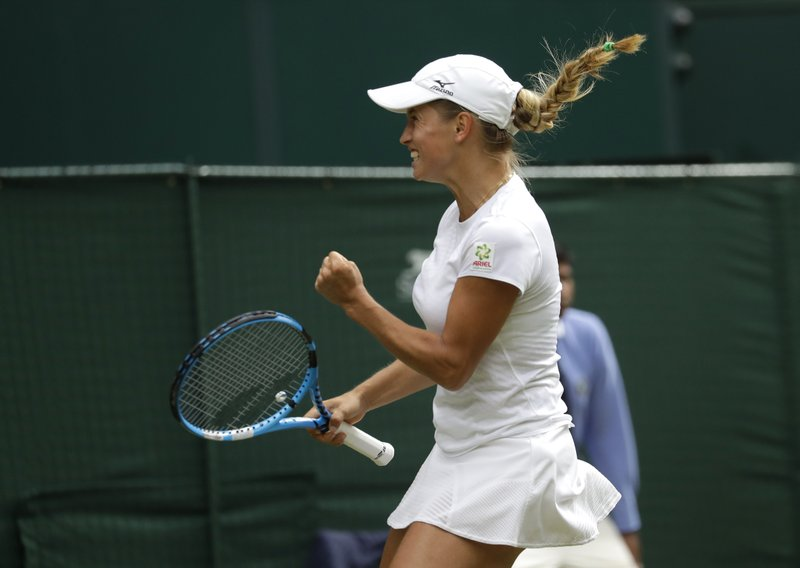 Kazakstan's Yulia Putintseva reacts after winning a point against Japan's Naomi Osaka in a Women's singles match during day one of the Wimbledon Tennis Championships in London, Monday, July 1, 2019. (AP Photo/Kirsty Wigglesworth)