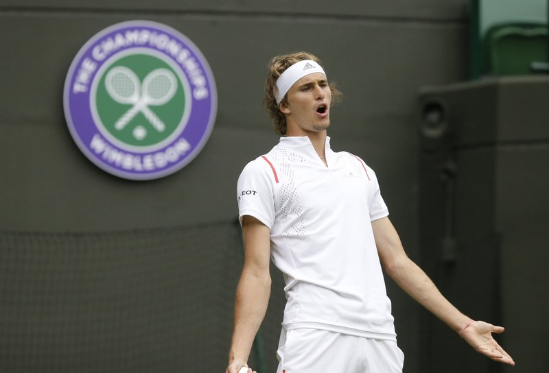 Germany's Alexander Zverev reacts after losing a point as he plays Czech Republic's in a Men's singles match during day one of the Wimbledon Tennis Championships in London, Monday, July 1, 2019. (AP Photo/Tim Ireland)