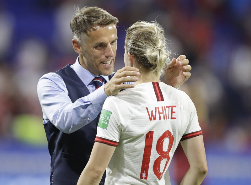 England head coach Philip Neville, left, comforts England's Ellen White after the Women's World Cup semifinal soccer match between England and the United States, at the Stade de Lyon, outside Lyon, France, Tuesday, July 2, 2019. (AP Photo/Alessandra Tarantino)