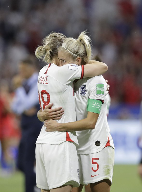 England's Ellen White, left, hugs England's Steph Houghton after the Women's World Cup semifinal soccer match between England and the United States, at the Stade de Lyon, outside Lyon, France, Tuesday, July 2, 2019. (AP Photo/Alessandra Tarantino)
