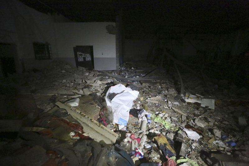 This photo shows the damages after an airstrike at a detention center in Tajoura, east of Tripoli Wednesday, July 3, 2019. An airstrike hit the detention center for migrants early Wednesday in the Libyan capital. (AP Photo/Hazem Ahmed)