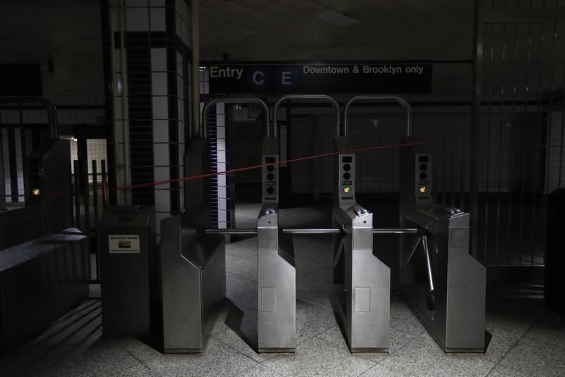 An entrance to the C and E trains at the 50th Street Subway Station is dimly lit during a power outage, Saturday, July 13, 2019, in New York. Authorities were scrambling to restore electricity to Manhattan following a power outage that knocked out Times Square's towering electronic screens and darkened marquees in the theater district and left businesses without electricity, elevators stuck and subway cars stalled. (AP Photo/Michael Owens)