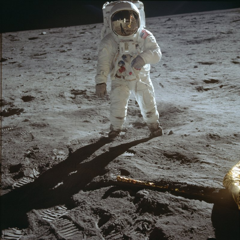 In this July 20, 1969 photo made available by NASA, astronaut Buzz Aldrin, lunar module pilot, walks on the surface of the moon near the leg of the Lunar Module
