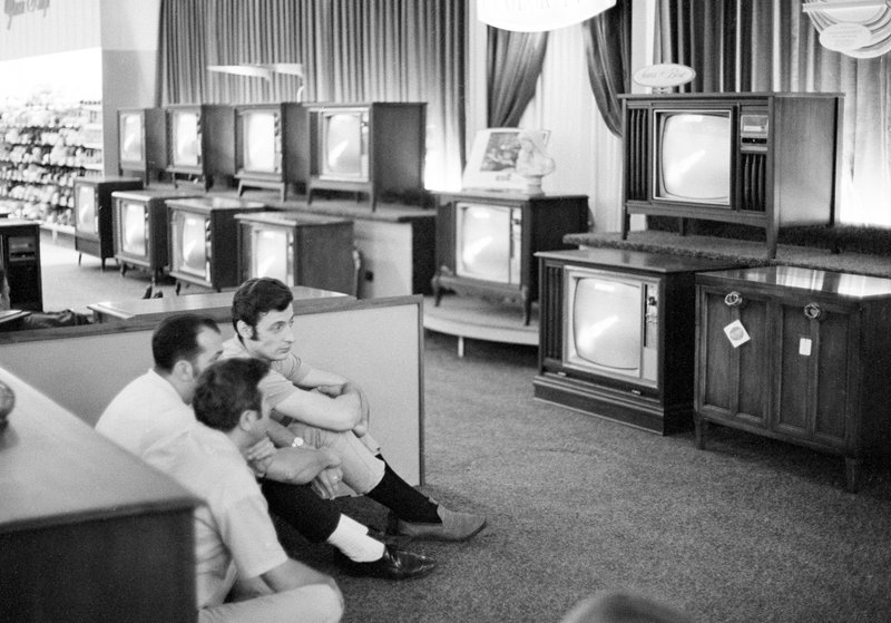 FILE - In this July 16, 1969 file photo, people watch the Apollo 11 Saturn V rocket launch on multiple TV's at a Sears department store in White Plains, N.Y. (AP Photo/Ron Frehm, File)