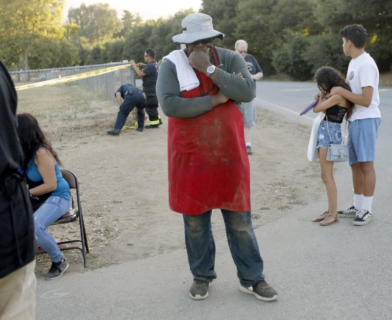 People leave the Gilroy Garlic Festival following a shooting in Gilroy, Calif., on Sunday, July 28, 2019. (Nhat V. Meyer/San Jose Mercury News via AP)