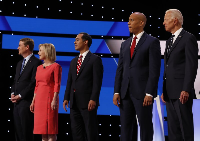 From left, Sen. Michael Bennet, D-Colo., Sen. Kirsten Gillibrand, D-N.Y., former HUD Secretary Julian Castro, Sen. Cory Booker, D-N.J., and former Vice President Joe Biden are introduced before the second of two Democratic presidential primary debates hosted by CNN Wednesday, July 31, 2019, in the Fox Theatre in Detroit. (AP Photo/Carlos Osorio)