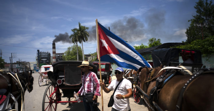 In this June 14, 2019 photo, horse-drawn carriages used for tourist rides remain inactive while drivers stop their work to participate in a demonstration organized with the Cuban government against article three of the Helms-Burton Act of 1996, in Havana, Cuba. (AP Photo / Ram n Espinosa)