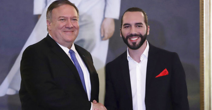 U.S. Secretary of State Mike Pompeo, left, shakes hands with Salvadoran President Nayib Bukele at the Presidential House in San Salvador, El Salvador, on Sunday, July 21, 2019. (AP Photo/Salvador Meléndez)