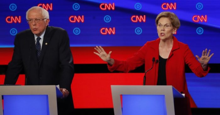 Sen. Bernie Sanders, I-Vt., and Sen. Elizabeth Warren, D-Mass., participate in the first of two Democratic presidential primary debates hosted by CNN Tuesday, July 30, 2019, in the Fox Theatre in Detroit. (AP Photo/Paul Sancya)