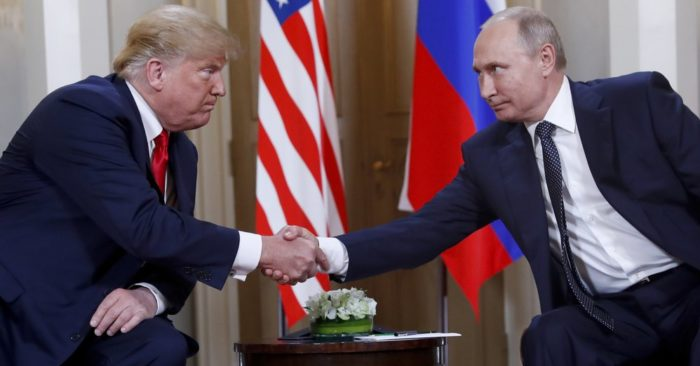 FILE - In this July 16, 2018, file photo, U.S. President Donald Trump, left, and Russian President Vladimir Putin shake hands at the beginning of a meeting at the Presidential Palace in Helsinki, Finland. (AP Photo/Pablo Martinez Monsivais, File)