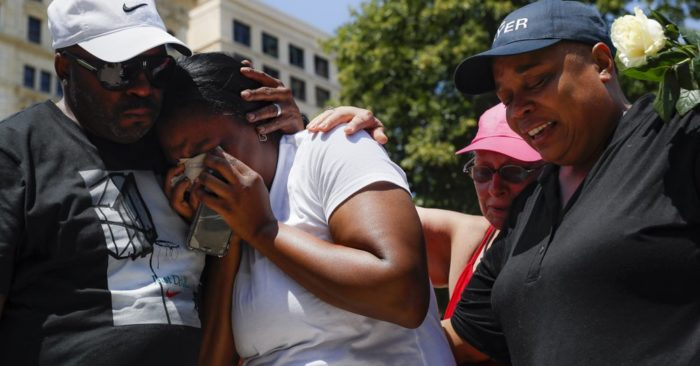 Mourners gather at a vigil following a nearby mass shooting, Sunday, Aug. 4, 2019, in Dayton, Ohio. Multiple people in Ohio have been killed in the second mass shooting in the U.S. in less than 24 hours, and the suspected shooter is also deceased, police said. (AP Photo/John Minchillo)
