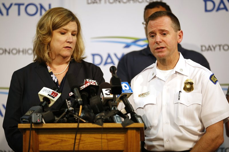 Dayton mayor Nan Whaley and police Lt. Col. Matt Carper give the latest update on the mass shooting during a news conference at the Dayton Convention Center in Dayton, Ohio, on Sunday, Aug. 4, 2019. (Sam Greene/The Cincinnati Enquirer via AP)
