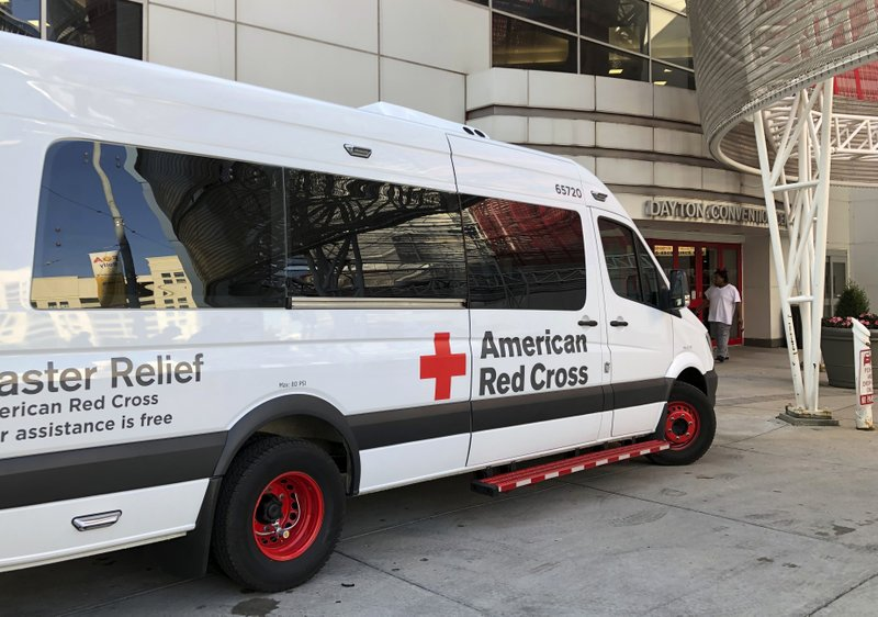 An American Red Cross disaster relief vehicle sits outside the Dayton Convention Center, where families of victims were asked to check in Sunday, Aug. 4, 2019, for news about their loved ones in Dayton, Ohio. (AP Photo/Julie Carr Smyth)