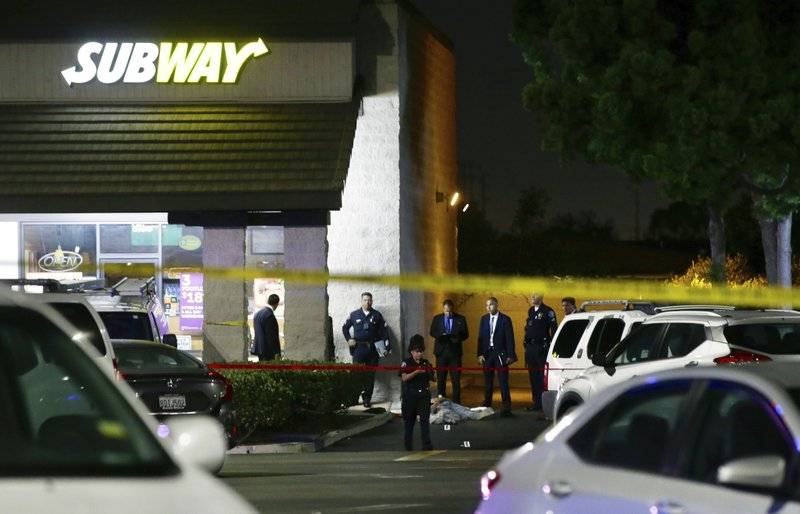 EDS NOTE: GRAPHIC CONTENT - Police work the scene of a stabbing in Santa Ana, Calif., Wednesday, Aug. 7, 2019. A man killed multiple people and wounded others in a string of robberies and stabbings in California's Orange County before he was arrested, police said Wednesday. (AP Photo/Alex Gallardo)