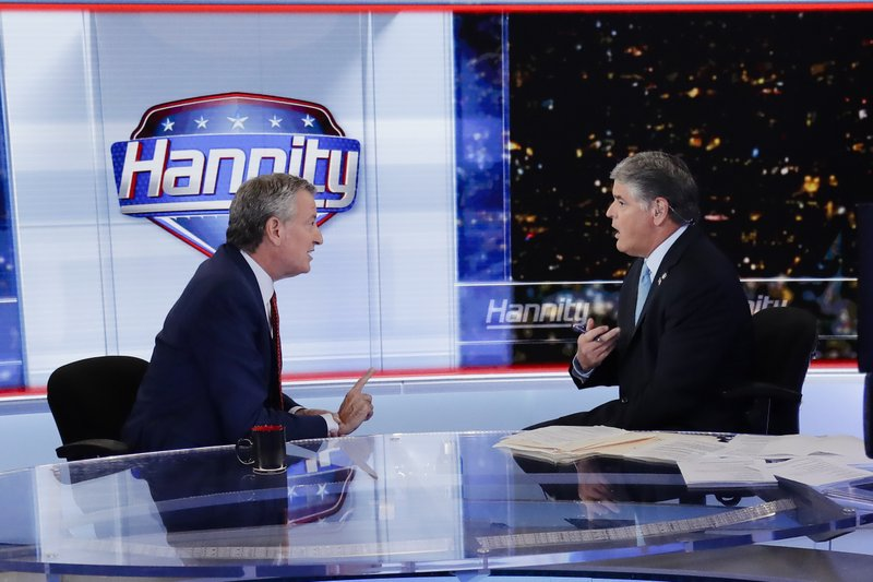 Fox News host Sean Hannity, right, interviews Democratic presidential candidate and New York Mayor Bill de Blasio during a taping of his show,