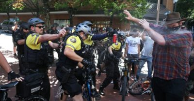 At least 13 arrested as antifa and right-wing rallies collide in Portland, Oregon