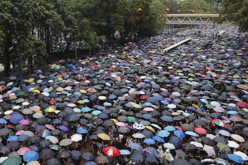 Protesters gather in Hong Kong Sunday, Aug. 18, 2019. Thousands of people streamed into a park in central Hong Kong for what organizers hope will be a peaceful demonstration for democracy in the semi-autonomous Chinese territory. (AP Photo/Kin Cheung)