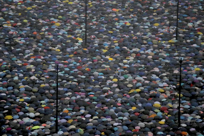 Protesters gather on Victoria Park in Hong Kong Sunday, Aug. 18, 2019. Thousands of people streamed into the park for what organizers hope will be a peaceful demonstration for democracy in the semi-autonomous Chinese territory. (AP Photo/Kin Cheung)