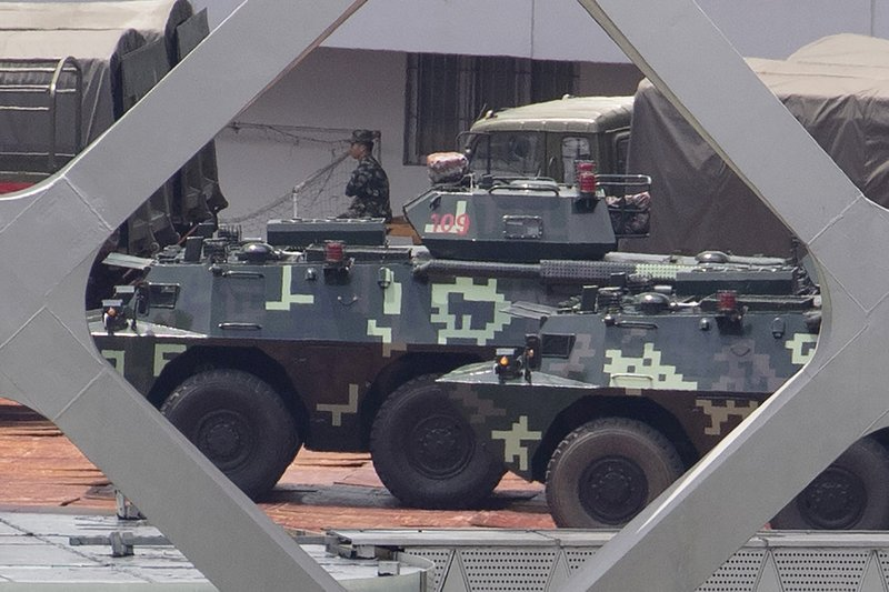 Armored carriers line up during drills at the Shenzhen Bay Stadium in Shenzhen in Southern China's Guangdong province on Sunday, Aug. 18, 2019. A spokesman for China's ceremonial legislature has condemned statements from U.S. lawmakers supportive of Hong Kong's pro-democracy movement. (AP Photo/Ng Han Guan)