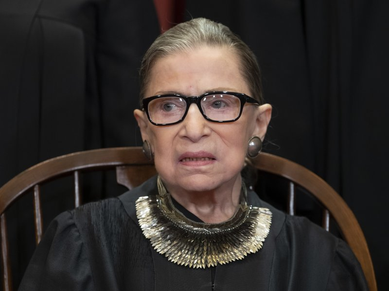 FILE - In this Nov. 30, 2018 file photo, Associate Justice Ruth Bader Ginsburg sits with fellow Supreme Court justices for a group portrait at the Supreme Court Building in Washington. The Supreme Court announced Aug. 23, 2019, that Ginsburg has been treated for a malignant tumor. (AP Photo/J. Scott Applewhite, File)