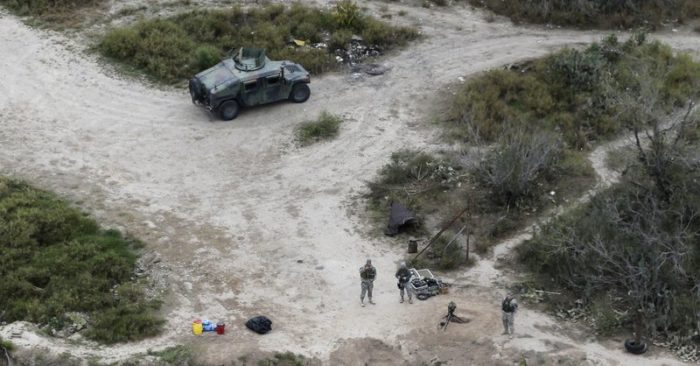 FILE - In this Feb. 24, 2015, file photo, members of the National Guard patrol along the Rio Grande at the Texas-Mexico border in Rio Grande City, Texas. (AP Photo/Eric Gay, File)