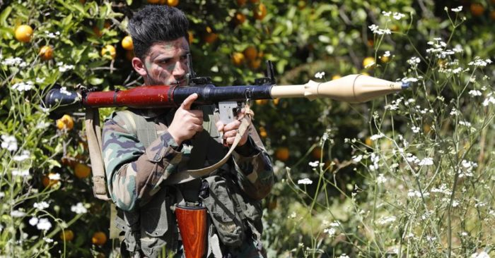 A Hezbollah fighter among orange trees in the southern Lebanese town of Naqoura on April 20, 2017. (AP/Hussein Malla)
