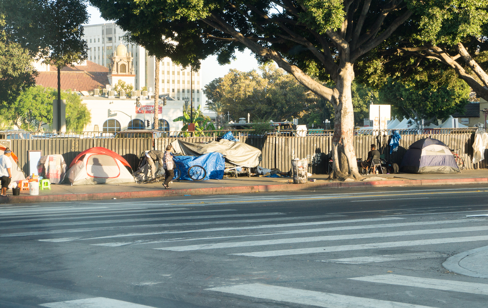 A row of tents and things of homeless people in Downtown LA. There are over 30 000 homeless living in the city of Los Angeles