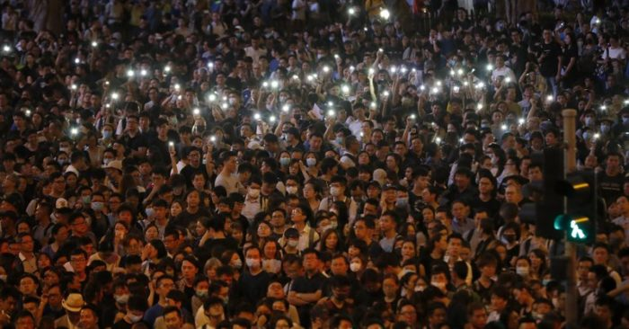 Protesters hold up the lights on their phones as they gather at a demonstration by civil servants in Hong Kong on Friday, Aug. 2, 2019. Protesters plan to return to the streets again this weekend, angered by the government's refusal to answer their demands, violent tactics used by police, possibly in coordination with organized crime figures. (AP Photo/Vincent Thian)