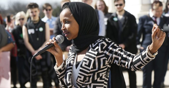 "U.S. Rep Ilhan Omar, D-Minn., speaks to support LGBTQ and allied high school students from across the state of Minnesota who marched to the State Capitol steps Thursday, March 21, 2019 in St. Paul, Minn. to urge lawmakers to protect LGBTQ Minnesotans and youth from the effects of so-called conversion ""therapy."" (AP Photo/Jim Mone)"