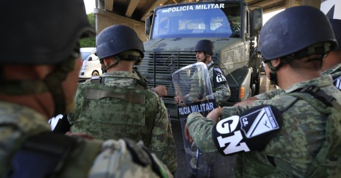 Military police with the badges of the new Mexican National Guard handle an immigration checkpoint in El Manguito, south of Tapachula, Mexico, June 19, 2019. (AP Photo / Rebecca Blackwell)
