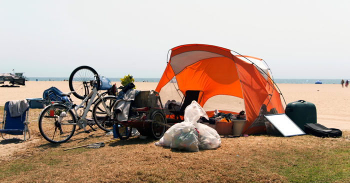 A homeless, tent and bicycles in Venice beach, California (shutterstock)
