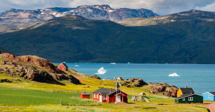 The view of Narsarsuaq in Greenland and the bay with icebergs. In the background mountains and blue sky with some clouds. (Shutterstock)