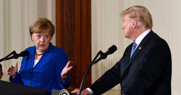 President Donald Trump heard German Chancellor Angela Merkel during a joint press conference at the White House in Washington on Friday, April 27, 2018. (AP Photo / Susan Walsh)