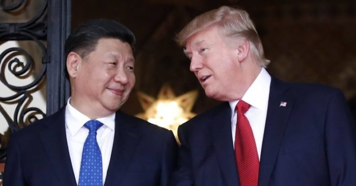 FILE - In this April 6, 2017 file photo, Chinese President Xi Jinping, left, smiles at U.S. President Donald Trump as they pose together with their wives for photographers before dinner at Mar-a-Lago in Palm Beach, Fla. China will finally open its borders to U.S. beef while cooked Chinese poultry is closer to hitting the American market as part of a U.S.-China trade agreement. Trump administration officials hailed the deal as a significant step in their efforts to boost U.S. exports and even America's trade gap with the world's second-largest economy. (AP Photo/Alex Brandon, File)