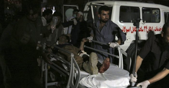 Afghan men take an injured man to a hospital after a major explosion in Kabul, Afghanistan, Sept. 2 2019. (AP/ Rahmat Gul)
