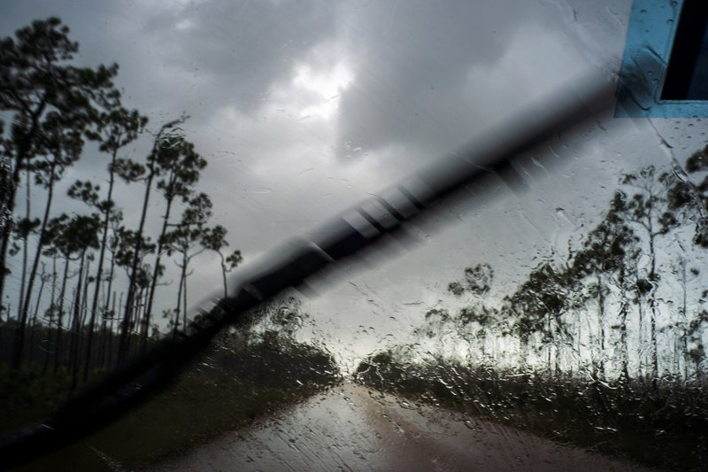 A car returns to the capital under the previous rain before the arrival of Hurricane Dorian in Freeport, Grand Bahama, Bahamas, Sunday Sept. 1, 2019. (AP Photo/Ramon Espinosa)