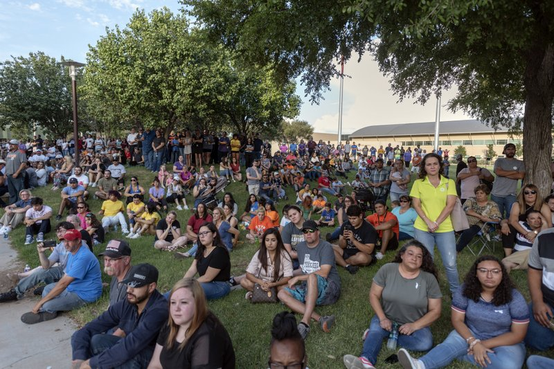 People attend a vigil for victims of a shooting spree the day before, Sunday, Sept. 1, 2019, at the University of Texas of the Permian Basin, in Odessa, Texas. (Jacy Lewis/Reporter-Telegram via AP)