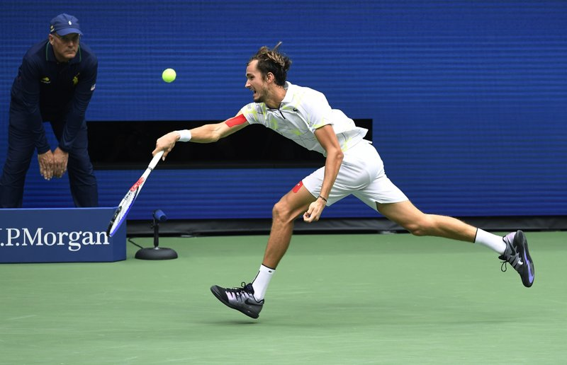 Daniil Medvedev, of Russia, returns a shot to Rafael Nadal, of Spain, during the men's singles final of the U.S. Open tennis championships Sunday, Sept. 8, 2019, in New York. (AP Photo/Sarah Stier)