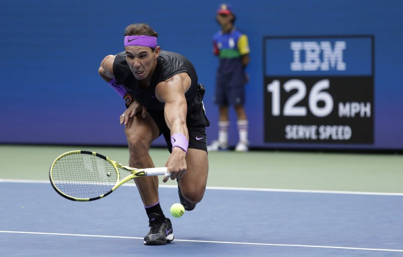 Rafael Nadal, of Spain, misses a shot from Daniil Medvedev, of Russia, during the men's singles final of the U.S. Open tennis championships Sunday, Sept. 8, 2019, in New York. (AP Photo/Adam Hunger)