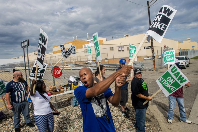 Flint resident Jashanti Walker, who has been a first shift team leader in the body shop for two years, demonstrates with more than a dozen other General Motors employees outside of the Flint Assembly Plant on Sunday, Sept. 15, 2019, in Flint, Mich. The United Auto Workers union says its contract negotiations with GM have broken down and its members will go on strike just before midnight on Sunday.  (Jake May/The Flint Journal via AP)