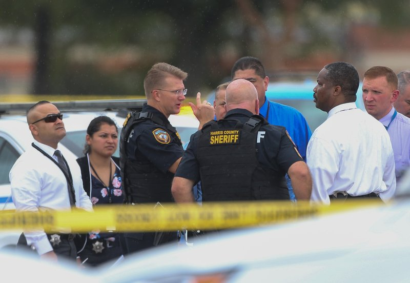 Law enforcement officers are present at a shopping plaza at West Road and Highway 6 North on Friday, Sept. 27, 2019, in Jersey Village, Texas. A Harris County Sheriff's deputy was shot during a traffic stop at Willancy Court and West Road. The deputy and was transported to a hospital with LifeFlight. ( Yi-Chin Lee/Houston Chronicle via AP)