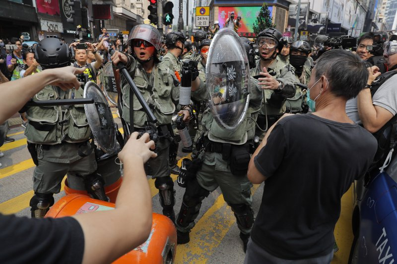 Hong Kong police react to protesters in Hong Kong on Sunday, Sept. 29, 2019. Sunday's gathering of protesters, a continuation of monthslong protests for greater democracy, is part of global